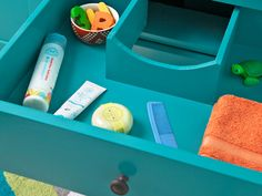 A vanity drawer with a cutout to accommodate the drain pipe squeezes in storage for sundries in a bath vanity