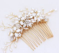 I made this beautiful, statement hair comb with freshwater pearls that I formed in the shape of flowers and gold rhinestones. I attached it