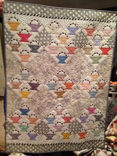 Love quilts with little baskets.