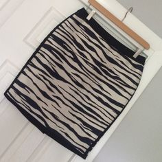 Zebra inspired dress skirt Tags attached! Never worn. Size 6 petite. 100% polyester. Lined with navy colored polyester lining. Black trim with navy and cream zebra inspired stripes. Skirt measures approximately 20 inches in length. Waist measures approximately 15 1/2 inches across. From smoke free and pet free home. Some small barely noticeable pulls due to the nature of the fabric. Try to photograph but cannot even see in the picture. See pic 3. Dry clean only. Ann Taylor Skirts