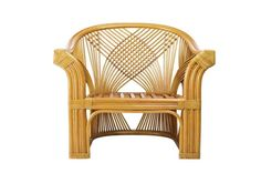 A natural rattan chair with a wicker back glows in a warm caramel tone.