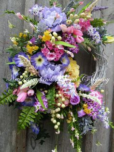 Spring Wreath, Easter Wreath, Summer Wreath, Designer Floral Wreath, Victorian Garden Wreath, Country French Wreath, Elegant Spring Wreath  Hingham Cottage Garden Wreath. Lush floral and greenery flourish in abundance upon a painted white grapevine wreath. A beautiful array of gorgeous Peonies, Hydrangeas, Roses, Tulips, Morning Glories, Lilacs and other garden favorites mingle with berry clusters and meadow grass in romantic spring and summer hues, resting upon fern leaves and lush…