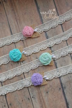 Romantic, vintage, and delicate. This tieback is made with vintage lace and a hand dyed rosette, embellished with burlap leaves and teardrop pearls. Fits newborns to older children.Big thanks to Blue Dandelion Photography for the beautiful photo.