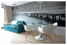 Decoración elegante en una planta difícil -absolutely fab grey/turquoise home with huge posters creating space.  Wonderful!