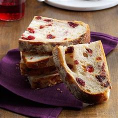 Rustic Cranberry & Orange Bread Recipe -Studded with cranberries, slices of pretty bread make the perfect holiday brunch treat. Don't forget to dust the top with flour for artisan look! —Megumi Garcia, Milwaukee, Wisconsin