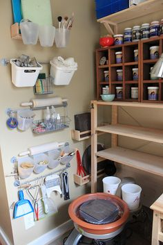 Various good storage ideas; remember to use shallow storage for glazes, so you can see which is which easily[by tashamck, via Flickr]