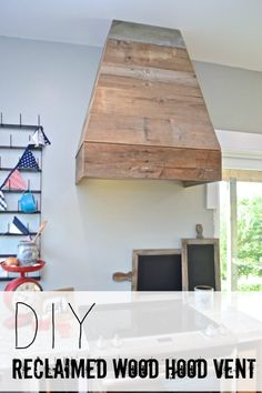 This DIY custom kitchen hood is made from reclaimed and rustic barn wood. This is such a grey addition to any kitchen design and decor. Paint it or leave it natural.