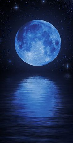 Blue moon reflection over the ocean.
