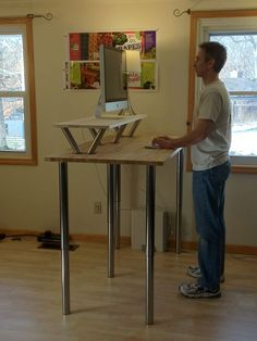 cool standing desk Idea. i like this one a lot, because of the big surface  under the monitor. i need that.