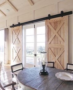 Barn doors and shearling upholstered chairs 🙌🏼 Never thought I'd utter those words in the same sentence, but when it works, it works! Photo I took a while back in the Owners Cottage at Cape Kidnappers in Hawkes Bay, Modern Farmhouse Kitchens, Modern Farmhouse Decor, Modern Country, Country Life, Barn Door Bookcase, Bay Window Decor, Farmhouse Dining Room Lighting, Interior Barn Doors, Home Living Room