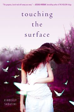 Touching the Surface by Kimberly Sabatini. In the afterlife for the fourth time, seventeen-year-old Elliot knows she has one last chance, but before she can begin her fourth life she must delve into her past, earn the forgiveness of her best friend, reconnect with her soul mate, and set things right for the future.