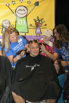What a guy! Rob Gronkowski gets his head shaved at the Kid's Cancer Buzz Off