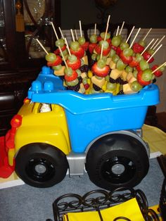 Under construction centerpiece with fruit skewers dump truck party, dump truck Construction Birthday Parties, Construction Party, 3rd Birthday Parties, Birthday Ideas, Fruit Birthday, Car Themed Birthday Party, Cars Trucks Birthday Party, Digger Birthday, Baby Boy Birthday Themes