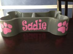 Personalize your dogs bowl! Bowls are made of plastic and the lettering and paw prints are made from window quality vinyl. Bowls are washable,