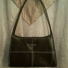 Prada vintage bag. It's in really good condition. I believe it is a replica but I'm not sure.  It has feet on the bottom.  Purchased from an estate sale. FENDI Bags Shoulder Bags