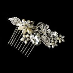 Comb 9804 Delightful and sweet, this charming floral hair comb feature a lovely collection of fabulous adornments including iridescent freshwater pearls, glittering clear crystals and dazzling clear rhinestones ornamented in gorgeous silver plated flowers and leaves. This stunning piece is perfect for brides, bridesmaids and even the prom queen! #timelesstreasure