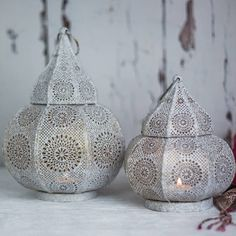 A beautiful Moroccan Lantern available to buy individually or as a set of 2 Lanterns.2 Sizes Available. Choose to buy an individual lantern in your choice of size or buy a set of 1 large and 1 small lantern.This Moroccan Lantern has a soft, rounded shape with a frame that has been perforated in a traditonal Moroccan style to create a stunning diffusion of light when the lantern is lit. Simply place a tea light or candle inside the lantern for a truly magical effect. Finished in elegant…