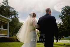 Lace wedding dress with sleeves. Wedding Dresses from Solutions Bridal in Orlando    Photography by Captiva