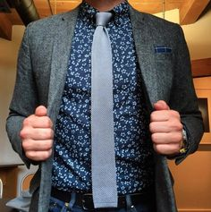 Gray Knit Tie paired with a Blue Floral Shirt and Blazer.