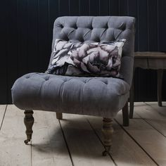 This fabulous chair opitimises modern country living with its elegant curves and sophisticated style.On trend with its button back design, the plush padding makes it a really comfortable chair to sit in. It is super soft to the touch and upholstered in a wonderful smoky grey brushed cotton fabric which feels like velvet. Lovely weathered legs finish it off beautifully with wonderful turned legs on castors at the front. This gorgeous chair is perfect for any room in the home and is also…