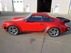 """1986 Porsche Carrera...In 1984, Porsche introduced the M491 option... it was commonly known as the """"Turbo-look"""". It was a style that resembled the Porsche 930 Turbo with wide wheel arches and the distinctive """"tea tray"""" tail. It featured the stiffer turbo suspension and the superior turbo braking system as well as the wider turbo wheels. (Write-up from Wikipedia)"""