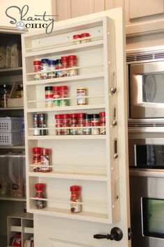 DIY Pantry Door Spice Rack...Also like the measuring spoons hanging on the side.