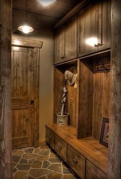 Beautiful mud room. The choice of wood, lights, and flooring are perfect.