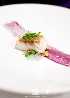 Pink Snapper sits on a Glass Noodles, Cashew and Green Peas