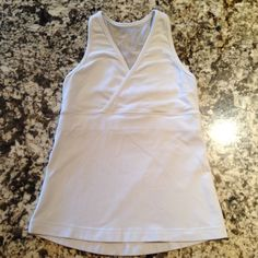 Lululemon Racerback Yoga Tank Top White Lululemon top with crossover front design and mesh back. Meant for low impact, like yoga. Has built in bra, with slits for inserts. Inserts not included. lululemon athletica Tops Tank Tops
