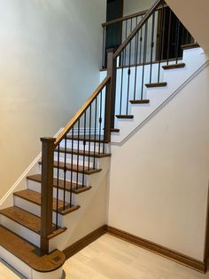 Combine 3 materials together and you get a master piece foyer staircase Wood Stair Treads, Wood Balusters, Wood Stairs, Staircase Railings, Painting On Wood, Ontario, Iron, Home Decor, Wooden Ladders