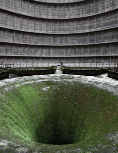 Abyss - Abandoned Construction of Nuclear Power Plant. Inside an abandoned cooling tower. In a small neighborhood known as Monceau-sur-Sambre, within the Belgian town of Charleroi, sits an abandoned power station. Abandoned Buildings, Abandoned Mansions, Old Buildings, Abandoned Places, Places Around The World, Around The Worlds, Cooling Tower, Water Cooling, Haunted Places