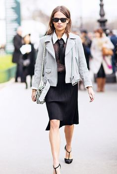 Gray leather jacket worn with a sheer pleated skirt