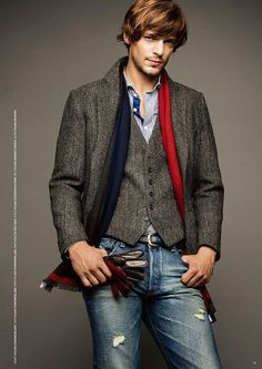 Tomorrowland FW2010- grey herringbone jacket, grey herringbone vest, blue striped shirt, red and blue scarf, black leather belt, worn blue jeans, black and red leather gloves