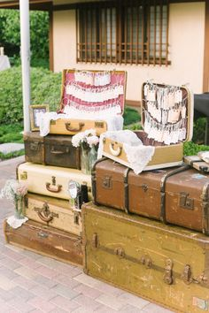 Escort cards hanging inside suitcases- great for a vintage and/or travel-themed wedding! // Photographer: Melissa Biador, Wedding Planner/Coordinator: Joyful Weddings & Events , Flowers & Decor: Forever Vintage Rentals, see more: http://theeverylastdetail.com/blush-vintage-travel-themed-wedding/