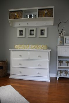 dresser changing table with storage shelving above. Love this idea, because when the child gets older you already have a dresser for them & don't have to get rid of the changing table.