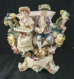 It looks to be a French majolica, signed only 82. It has three pink and green acanthus leaf shape feet, two tree trunk shape handles with applied flowers and leaves. The body of the jardinière is covered with large roses, flowers and leaves. | eBay!