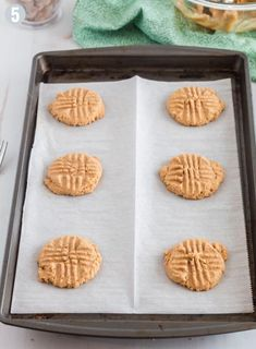 Parchement paper-lined baking sheet of freshly baked peanut butter cookies Best Peanut Butter Cookies, Sugar Cookies, Homemade Sausage Rolls, Cookie Recipes For Kids, 3 Ingredients, Kids Meals, Keto Recipes, Baking Sheet, Freshly Baked
