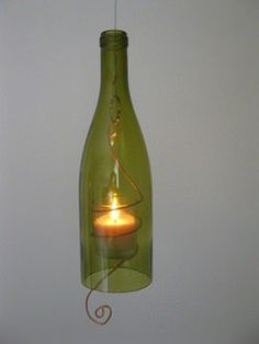 Hanging wine bottle candles are made from recycled wine bottles and salvaged electrician's copper. ++ More information at Teena Stewart website ! Idea sent by Teena Stewart ! Wine Bottle Candle Holder, Wine Bottle Corks, Glass Bottle Crafts, Bottle Art, Candle Holders, Jar Candle, Cutting Glass Bottles, Cut Bottles, Bottle Cutting