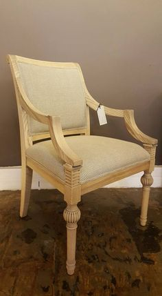 Chair by Pierre Cronje upholstered in Basket Weave colour Bone/Linen