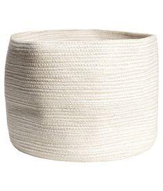 Storage Basket $17.95 Light beige  Product Description   Description  Storage basket in thick cotton fabric. Diameter 13 3/4 in., height 9 3/4 in. Details  100% cotton. Do not wash
