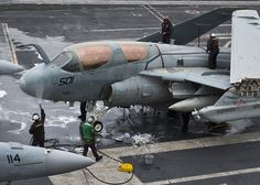 PACIFIC OCEAN (April 12, 2013) Sailors wash an EA-6B Prowler assigned to the Gray Wolves of Electronic Attack Squadron (VAQ) 142 on the flight deck of the aircraft carrier USS Nimitz (CVN 68). Nimitz is currently underway for a Sustainment Training Exercise in preparation for an upcoming deployment. (U.S. Navy photo by Mass Communication Specialist 3rd Class Raul Moreno Jr./Released)