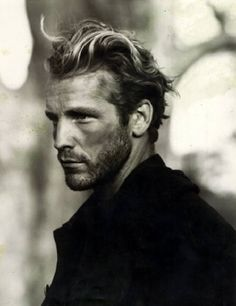 This is how I picture Jamie Fraser looks. I have the hardest time imagining the red hair, but in BandW, this is believable... Cat eyes, high cheek bones, long straight nose, and masculine. {who is this guy??}