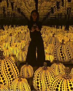 Pumpkins everywhere! Victoria Beckham enjoyed theYayoi Kusama exhibition at the Victoria Miro Gallery in North London on Tuesday