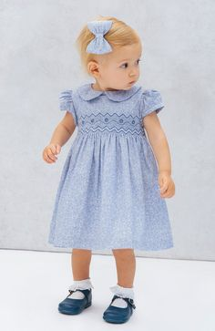 Shop Confiture for Trotters Baby Girls Smocked Dress in Catherine Blue Floral Print. Discover more in our Baby Girl's Dress collection for ages newborn 24 months, online from Trotters Childrenswear. Smocked Baby Clothes, Girls Smocked Dresses, Baby Girl Dresses, Baby Boy Outfits, Baby Girls, Boy Dress, Baby Girl Patterns, Baby Clothes Patterns, Sewing Patterns