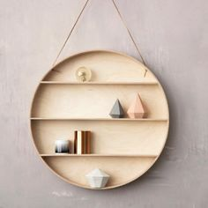 The Round Dorm will fit in any home and will give the wall an elegant unique and delicate look. Use it for storage or all your favourite little things. It is made of beech and birch plywood hangs in a leather string and comes with a beech hook