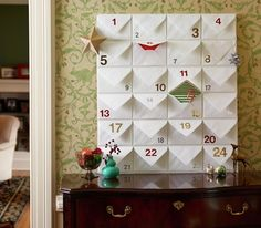 Make your own Advent calendar using lined envelopes and stick-on-numbers to transform a large bulletin board. Lean this up against the buffet next year for our craftivity calendar. Christmas And New Year, All Things Christmas, Holiday Fun, Christmas Holidays, Christmas Crafts, Christmas Decorations, Holiday Decor, Christmas Countdown, Christmas Tables