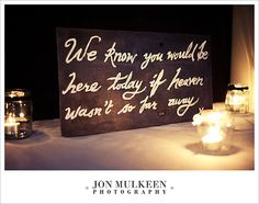 Sign to remember absent loved ones at a wedding.