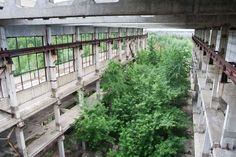 The overgrown ruins of an industrial building in the Voronezh region For years, photographers have traveled across Russia finding and photographing intriguing ghost towns, empty Soviet factories, toppling houses, and crumbling churches. Abandoned Houses, Abandoned Places, Underwater Ruins, Ruined City, Temple Ruins, Union City, Bohemian House, Castle Ruins, Ancient Ruins