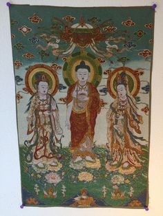 Buy Buddhist art thangka Shakyamuni Buddha with Two Disciples. This vertical embroidered tapestry is available in two variants. This Feng Shui art will lift the energy of your office or home. Enjoy fr
