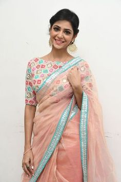 Beautiful peach saree with colourful blouse with half sleeve